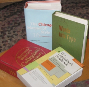 My constant editorial companions. Clockwise from top: The Chicago Manual of Style, Words into Type, Amy Einsohn's Copyeditor's Handbook, and Merriam-Webster's Collegiate Dictionary.
