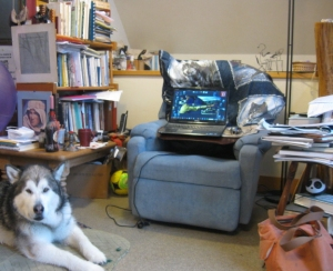 When my workspace is messy, it means things are happening there. That's Travvy, one of my muses, on the left.