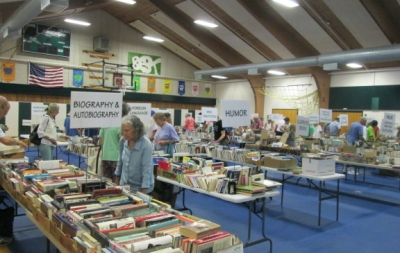 The book sale takes place in the elementary school gym. All the sorting and shelving is done by volunteers.