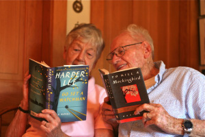 Cynthia and Howie comparing copies of